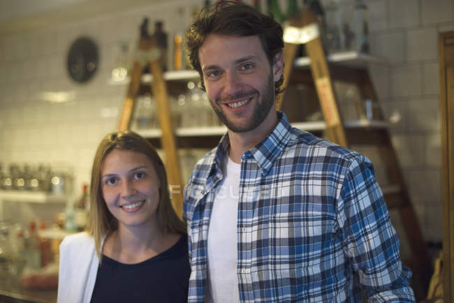 Portrait of female and male Restaurant waiting staff — Stock Photo