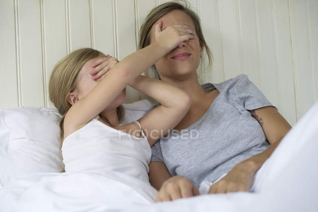 Mother and daughter bonding in the bed — Stock Photo