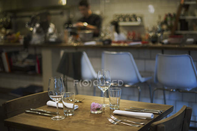 Restaurant table set for guests — Stock Photo