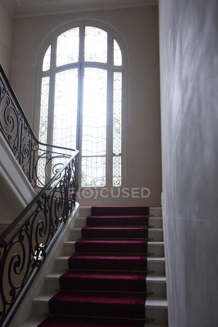 Stairway with wrought  bannister — Stock Photo