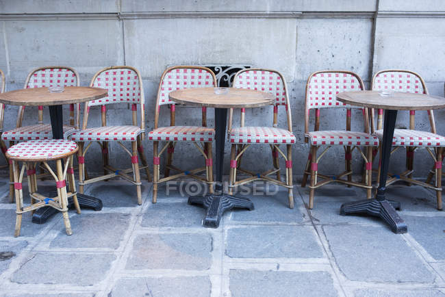Tables and chairs at cafe — Stock Photo
