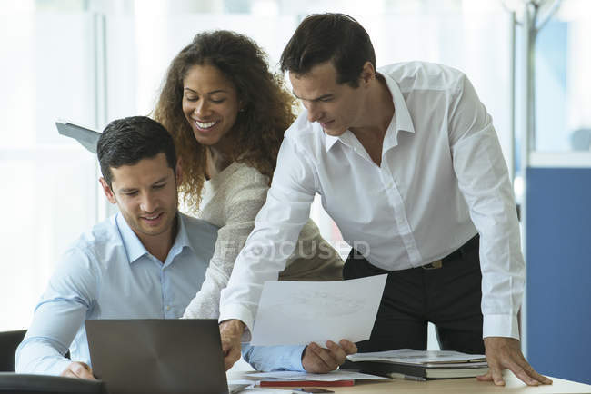 Business professionals reviewing document together. Camaraderie in the office builds morale — Stock Photo