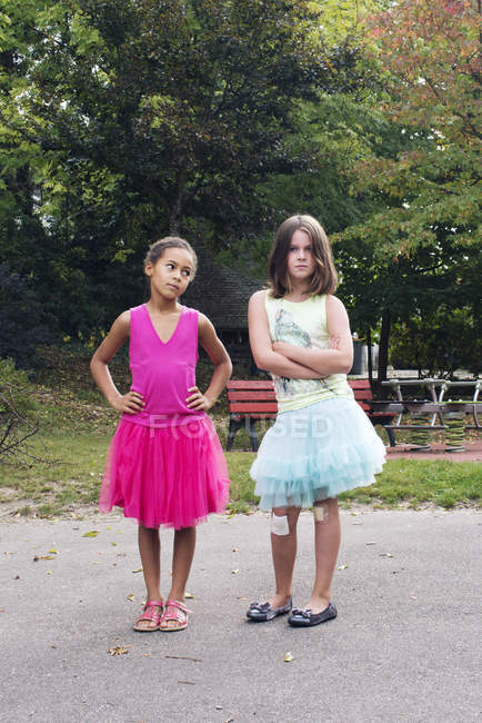 Girls dressed in tutus with tough expression on faces — Stock Photo