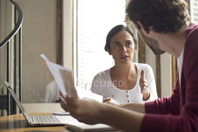 Couple discussing household expenses at home — Stock Photo