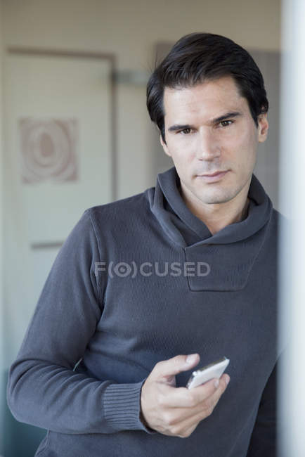 Portrait of Man holding cell phone — Stock Photo