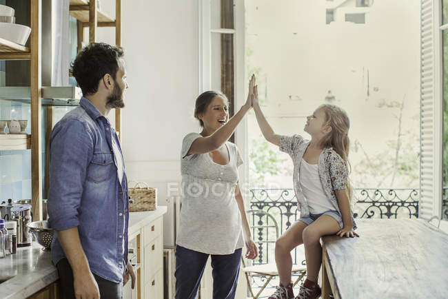 Mother exchanging high five with daughter — Stock Photo