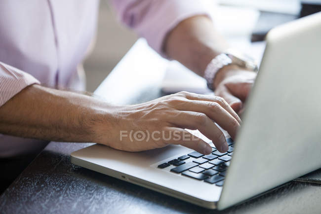 Cropped shot of Man using laptop computer — Stock Photo