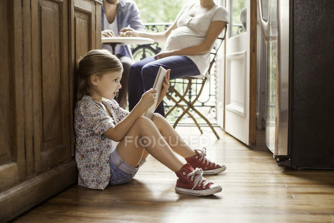 Girl engrossed in video streaming on digital tablet — Stock Photo