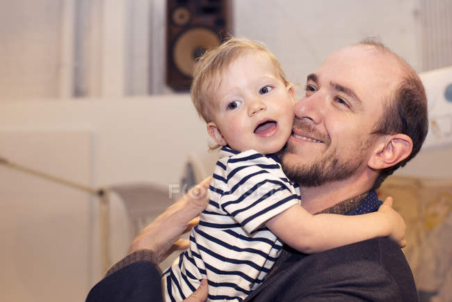 Toddler hugging smiling father — Stock Photo