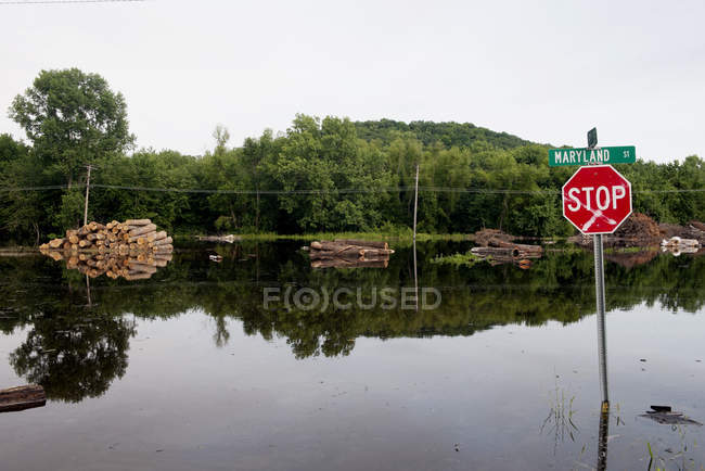 Flooded street with stop road sign after rain, missouri, usa — Stock Photo