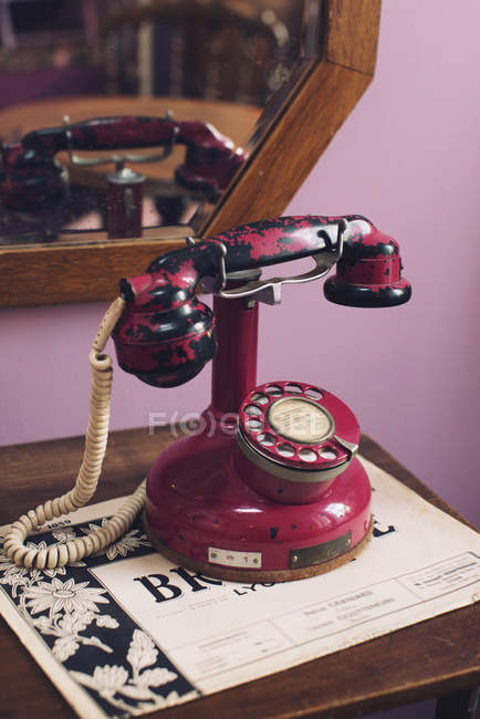 Close up of red Antique telephone on the table — Stock Photo