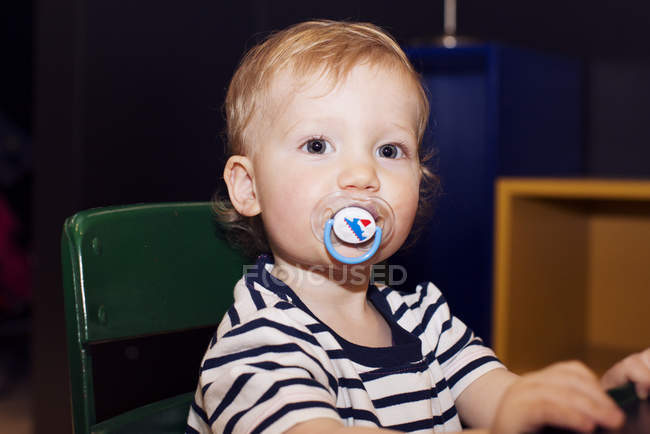 Portrait of Toddler with a pacifier in his mouth — Stock Photo