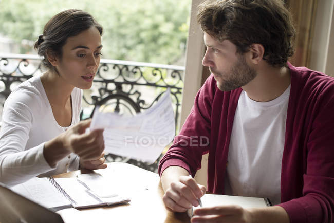 Couple chatting about monthly household bills — Stock Photo