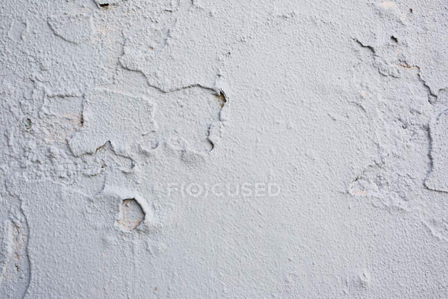 Close up of old cracked white wall — Stock Photo