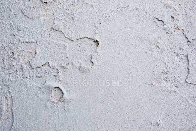 Close-up da velha parede branca rachada — Fotografia de Stock