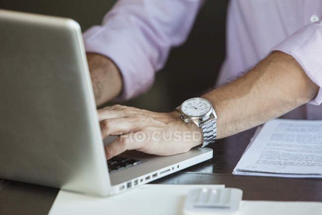 Cropped shot of Businessman using laptop computer — Stock Photo