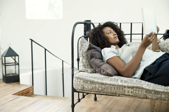 African american woman engrossed in good book — Stock Photo