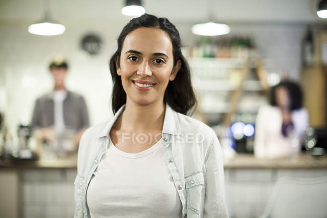 Portrait of smiling cafe employee — Stock Photo