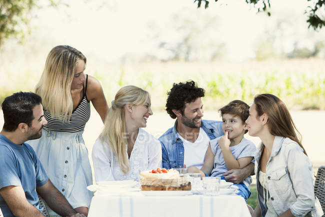Family and friends spending time together outdoors — Stock Photo