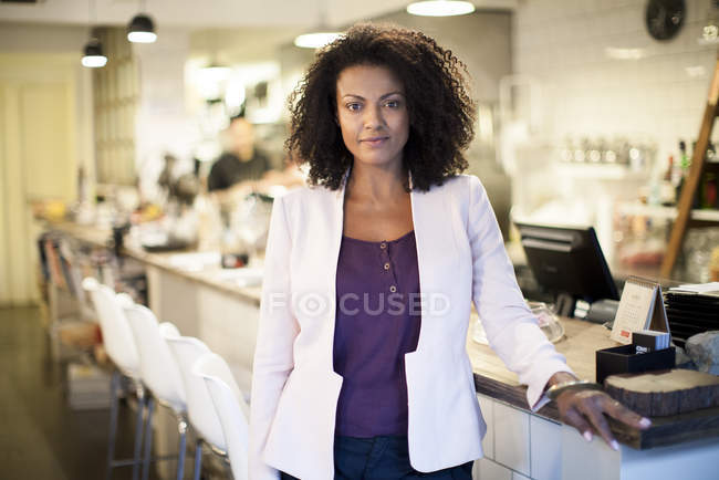 Portrait of restaurant owner at bar stand — Stock Photo