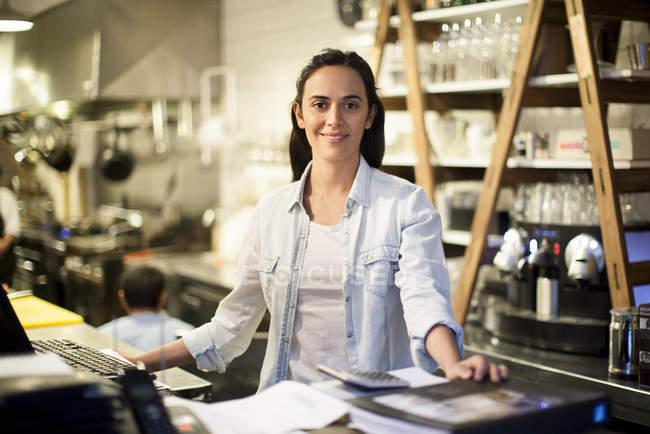 Portrait of Restaurant employee  at cash desk — Stock Photo