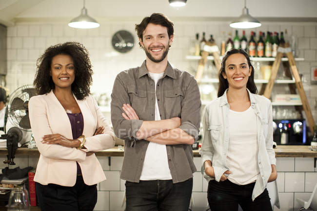 Portrait of smiling restaurant business partners — Stock Photo