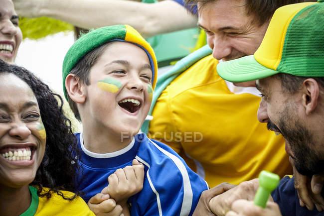 Brazilian football fans celebrating victory at match — Stock Photo