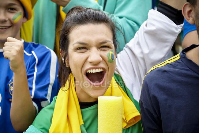 Brazilian football fans cheering at match — Stock Photo