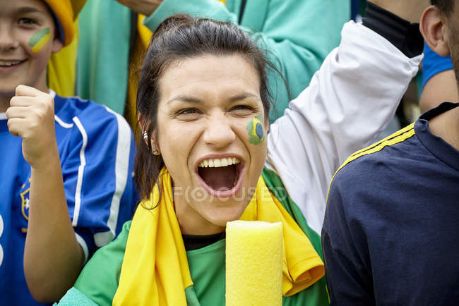 Brazilian football fans cheering at match — Stock Photo