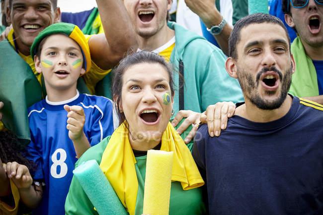 Brazilian football fans cheering at football match — Stock Photo