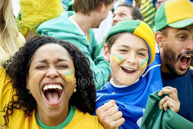Brazilian football fans watching football match — Stock Photo