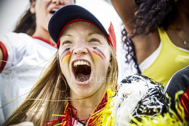 German football fan cheering at match — Stock Photo