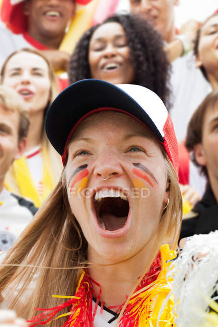 Portrait of German football fan cheering at match — Stock Photo