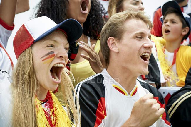 German football fans watching football match — Stock Photo