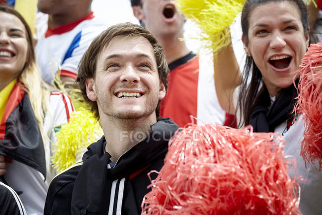 German football fans cheering at match — Stock Photo