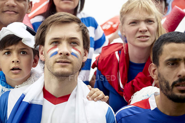 French football fans watching match attentively — Stock Photo