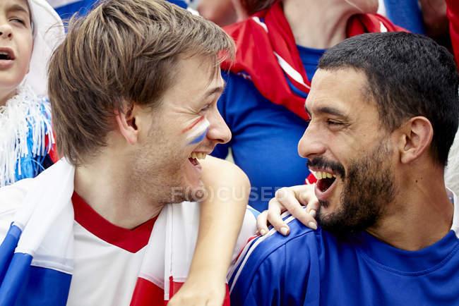 French football fans enjoying match — Stock Photo