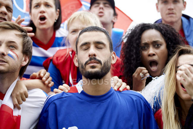 French football fans looking shocked and disappointed at match — Stock Photo