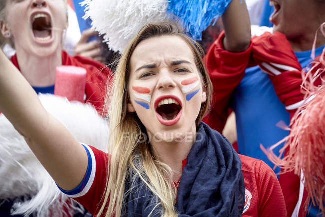 French football fans cheering at match — Stock Photo