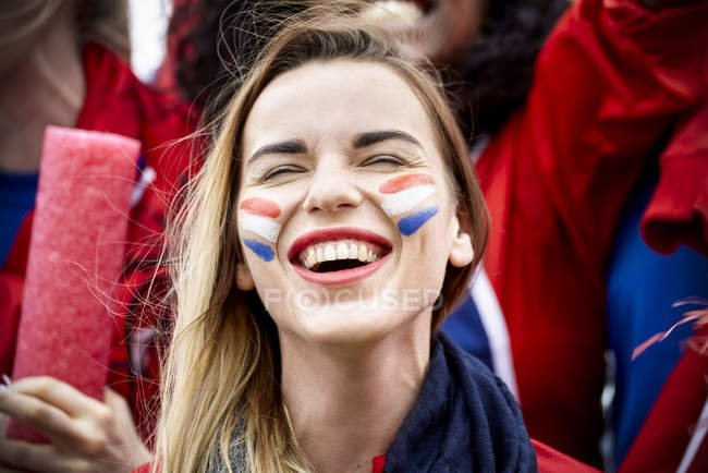 French football fan smiling at match, portrait — Stock Photo