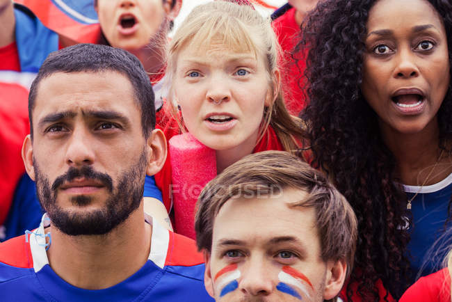 French football fans anxiously watching match — Stock Photo