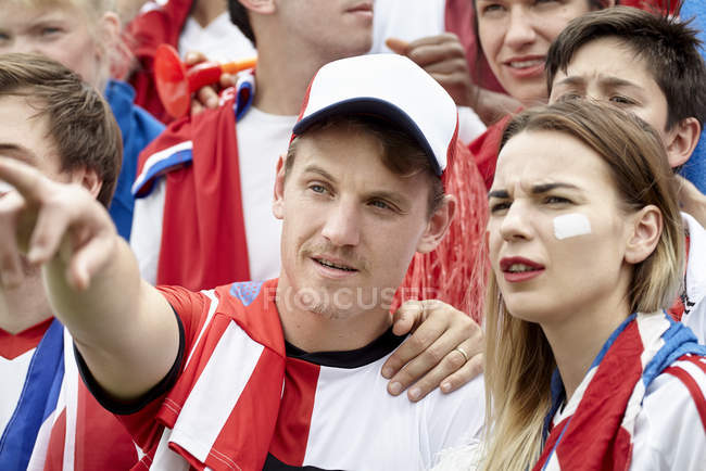 British football fan pointing at match — Stock Photo