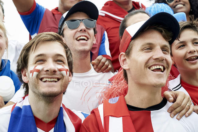 British football fans watching football match — Stock Photo