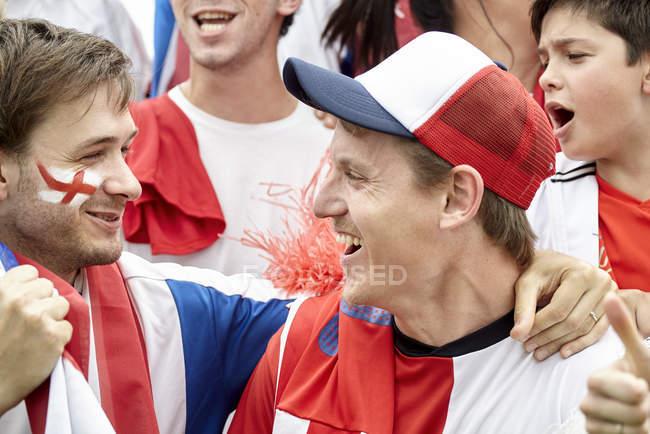 British football fans cheering at match — Stock Photo