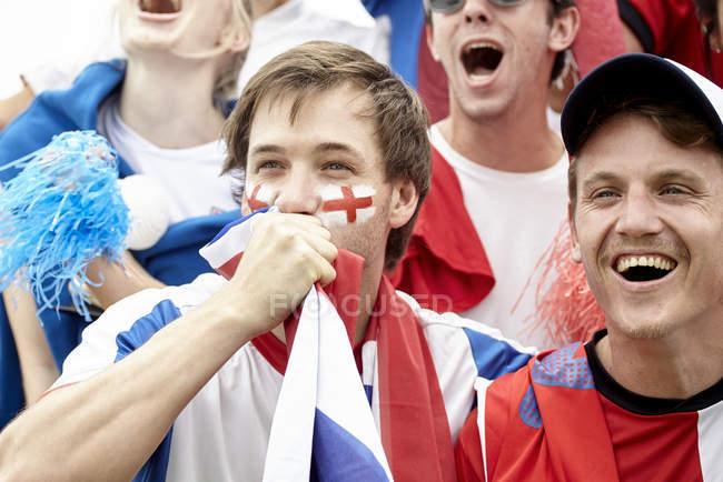 British football fans having fun at match — Stock Photo