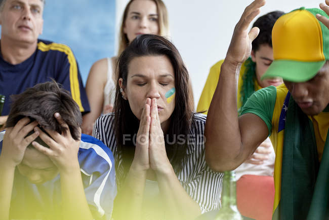 Upset Brazilian football fans while watching match at home — Stock Photo