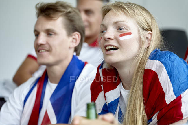 British football fans watching match at home — Stock Photo