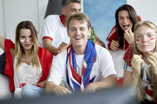 British football fans watching match on TV at home — Stock Photo
