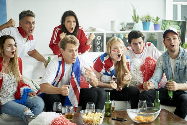 English soccer fans watching match together at home — Stock Photo