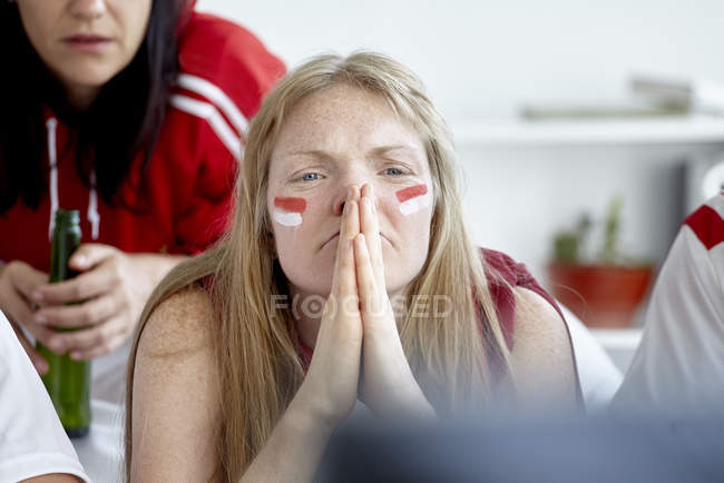 Sports enthusiasts anxiously watching match on TV — Stock Photo